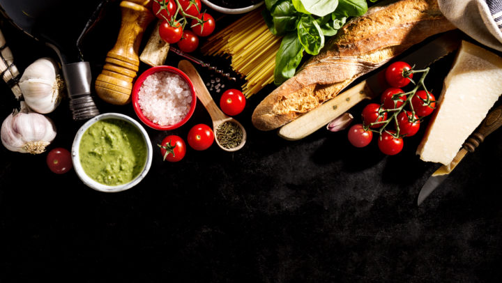 Tasty fresh appetizing italian food ingredients on dark background. Ready to cook. Home Italian Healthy Food Cooking Concept. Toning.